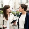 two casual businesswomen talking listening